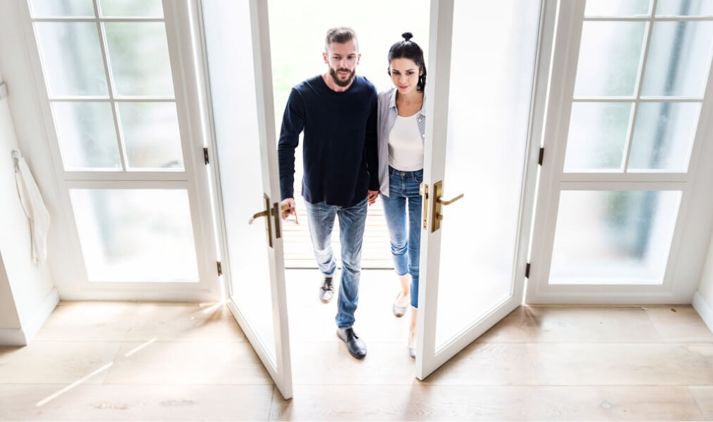 couple entering in new house